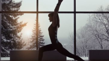 woman doing yoga during winter